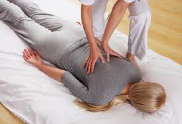 woman receiving shiatsu massage